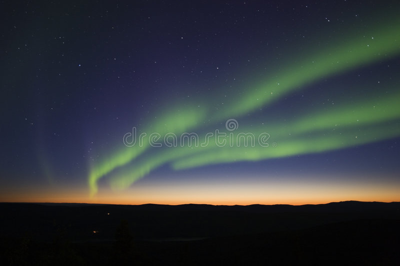 3 aurora strips over twilight stock images