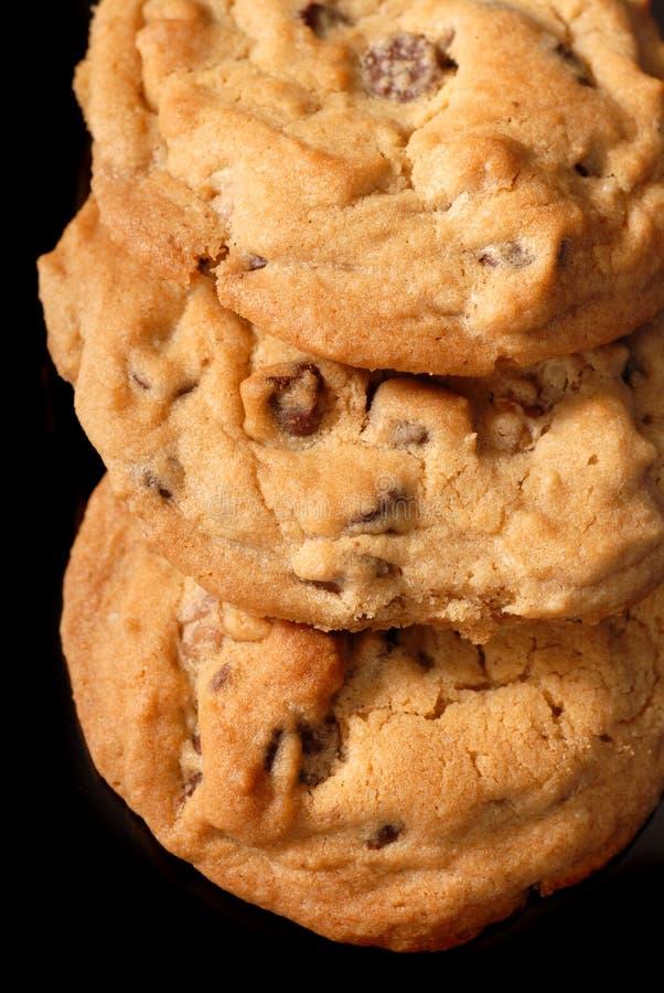 3 biscuits de puce de chocolat images stock