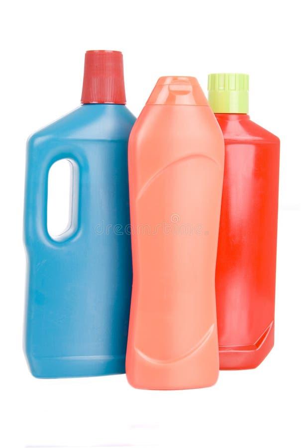 3 bouteilles de différents détergents photos stock