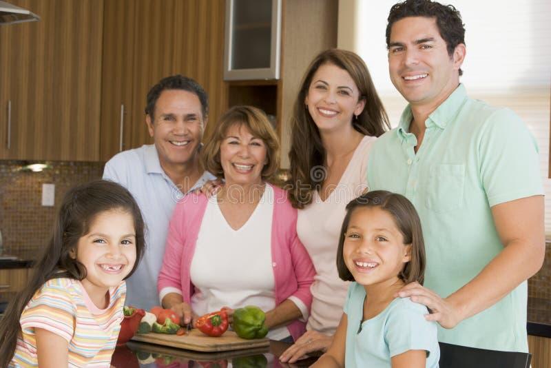3 family generation meal preparing together στοκ εικόνες