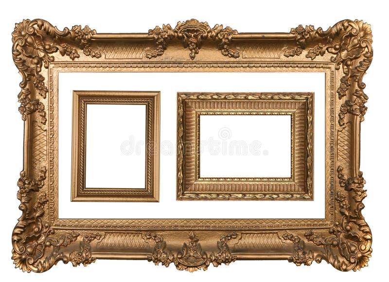 3 frames de retrato vazios da parede do ouro decorativo imagens de stock royalty free