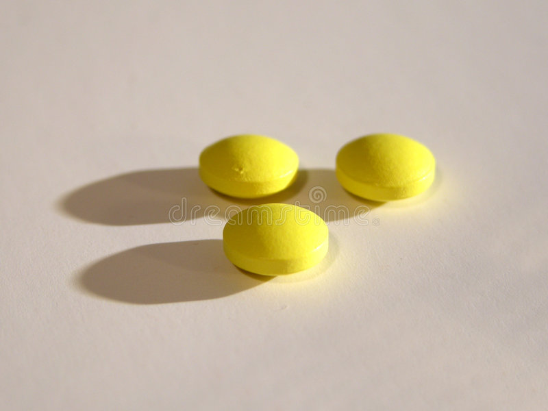 Download 3 gelbe Pillen stockfoto. Bild von drogen, pille, drugstore - 43672