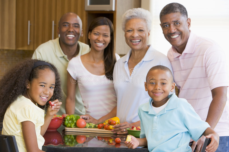 3 Generation Family Preparing a Meal stock image