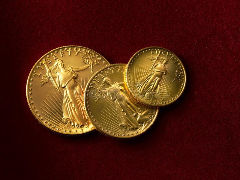 3 gold liberty coins stock image