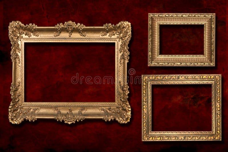 3 gouden Frames tegen een Achtergrond Grunge royalty-vrije illustratie