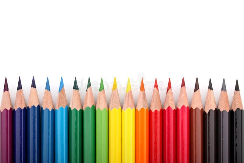3 kulöra blyertspennor arkivbilder