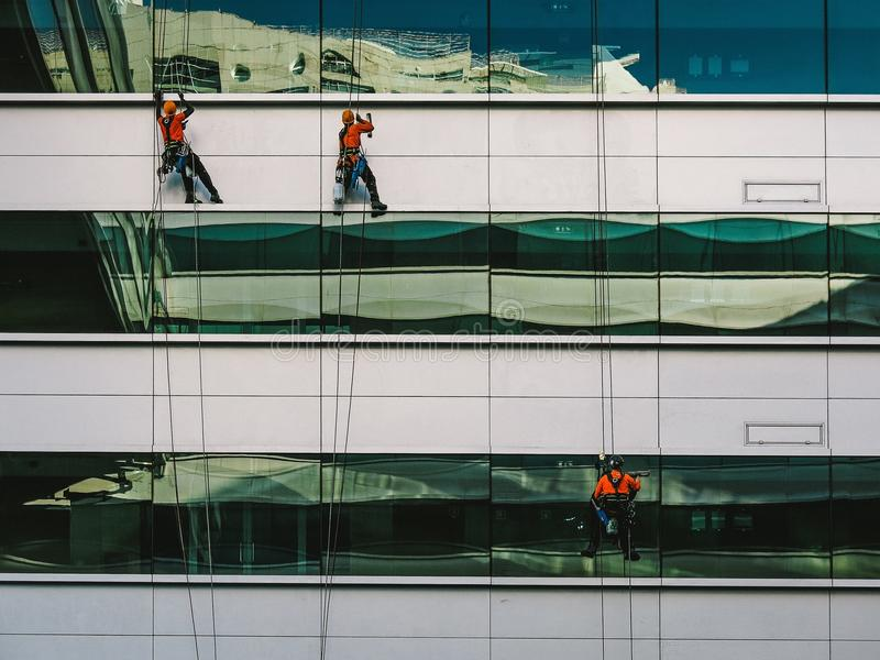 3 People Hanging On White High Rise Building During Daytime Free Public Domain Cc0 Image