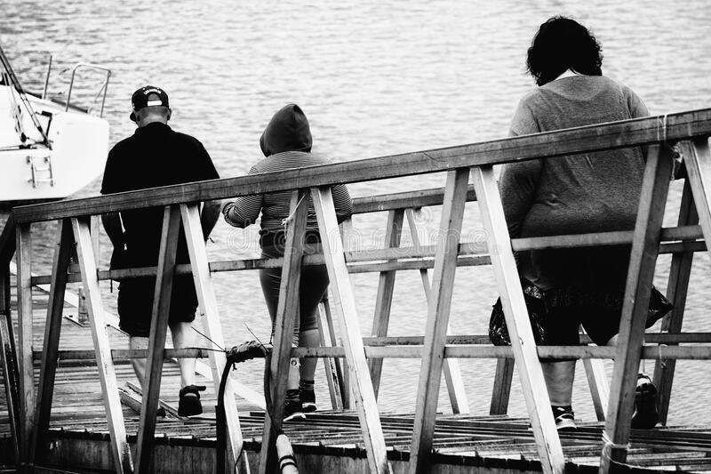 3 Person Walking On Bridge Black And White Photo Free Public Domain Cc0 Image