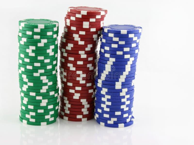 3 pilas de virutas del casino fotografía de archivo