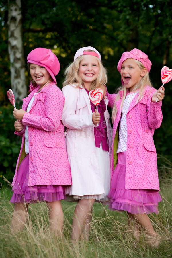 3 pink jacked sisters royalty free stock photo