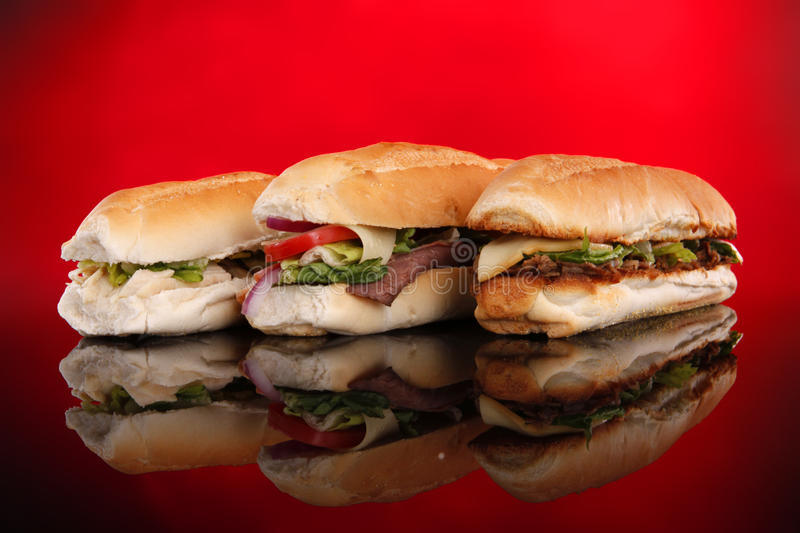 3 popular sandwiches on red royalty free stock images