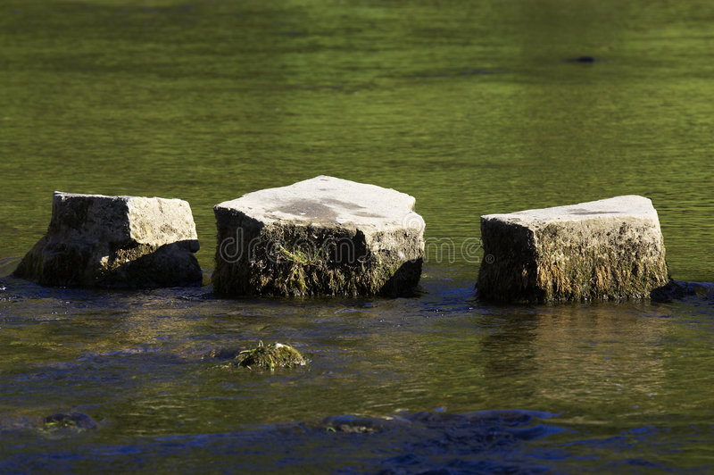 3 stepping stones in river stock photography