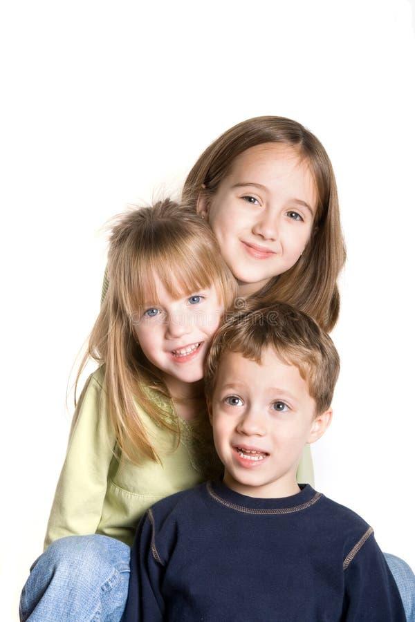 3 syskon arkivbild