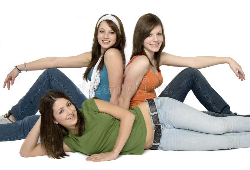 3 teenage girls. Three teenage girls wearing colorful clothes seated on floor royalty free stock photo