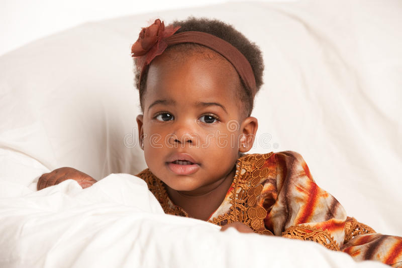 3 Year Old African American Girl Sit On Bed Royalty Free Stock Photography