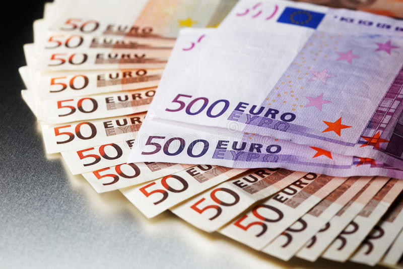 3000 Euro on a shiny metal board royalty free stock photo
