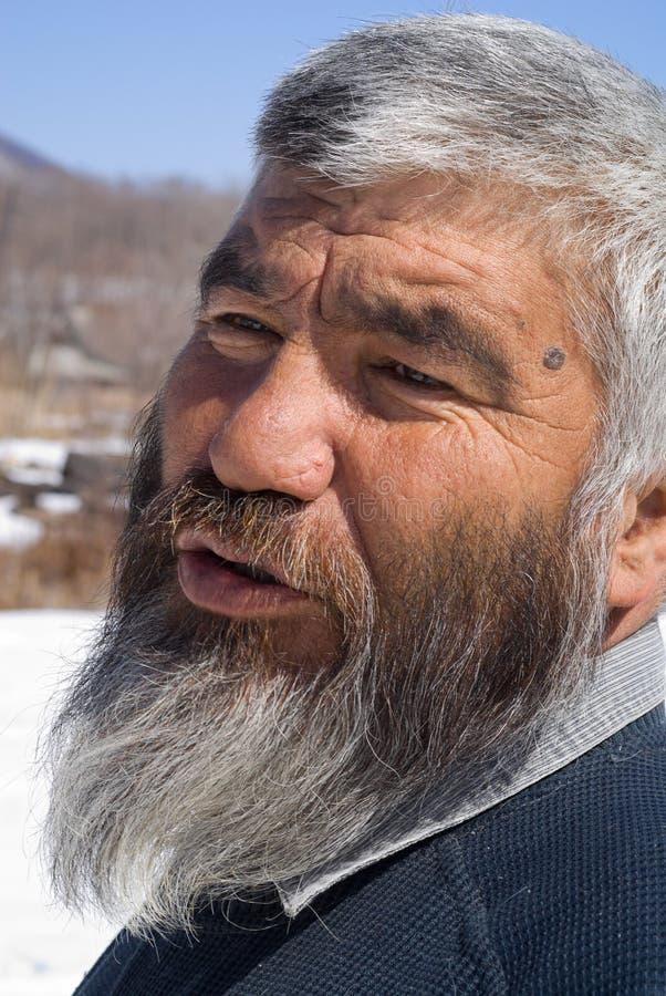 33 mongoloida gammala för man arkivfoton