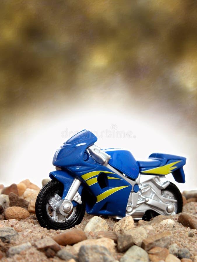 蓝色摩托车玩具 免版税图库摄影