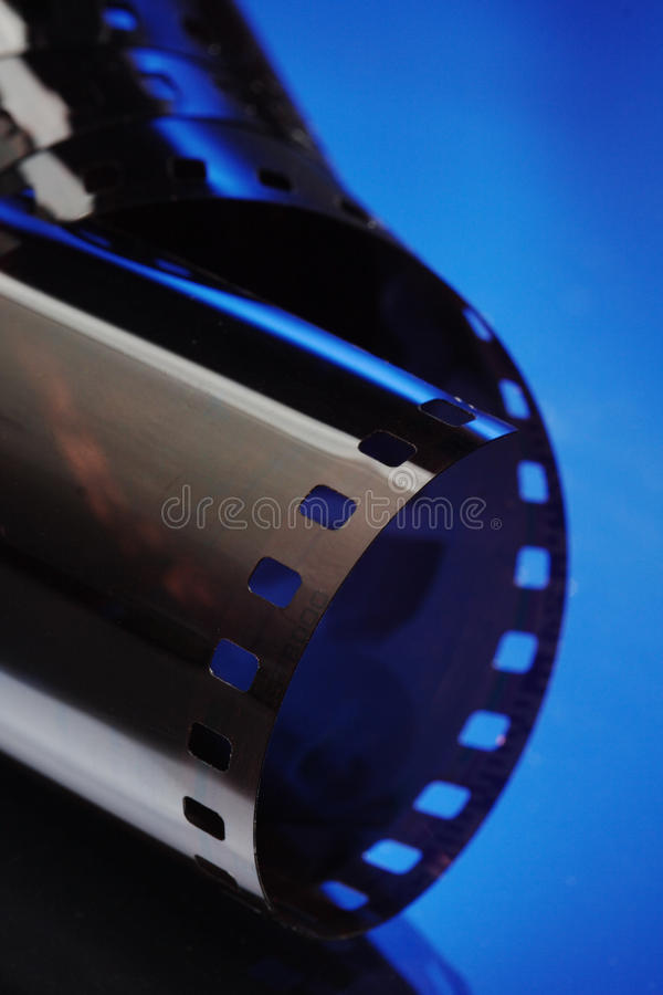35 mm film. On blue background stock photo