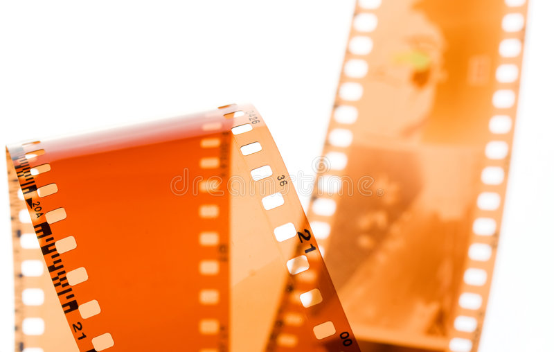 35 mm film strip on white. 35 mm film strip rolled on white background royalty free stock image