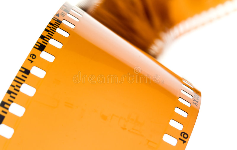 35 mm film strip on white. 35 mm film strip rolled on white background royalty free stock photos