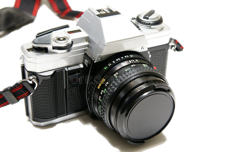 35mm Camera. Picture of the 35mm minolta x-370 with 50mm lens isolated on the white background stock photos