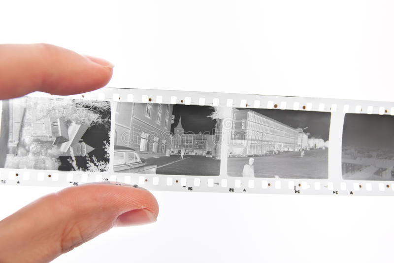 35mm filmstrip. In hand on white isolated background royalty free stock photography