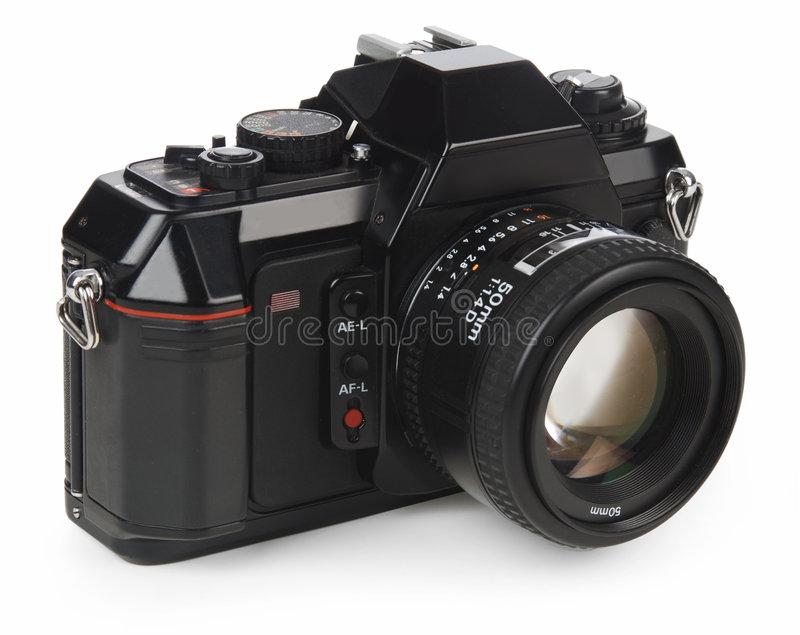 35mm SLR camera. Isolated on white with clipping path stock photography