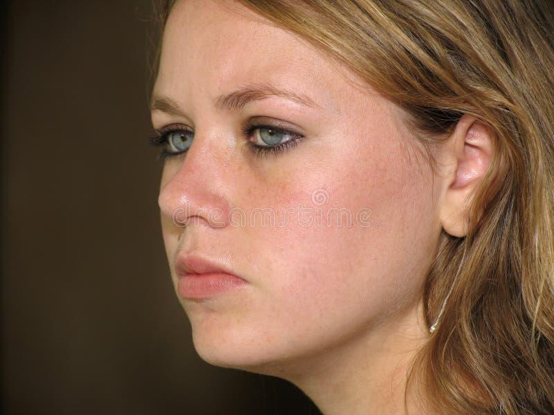面对青少年的女孩s 免版税库存照片