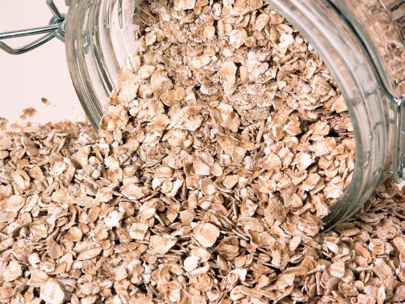 食物溢出的燕麦原始 库存图片