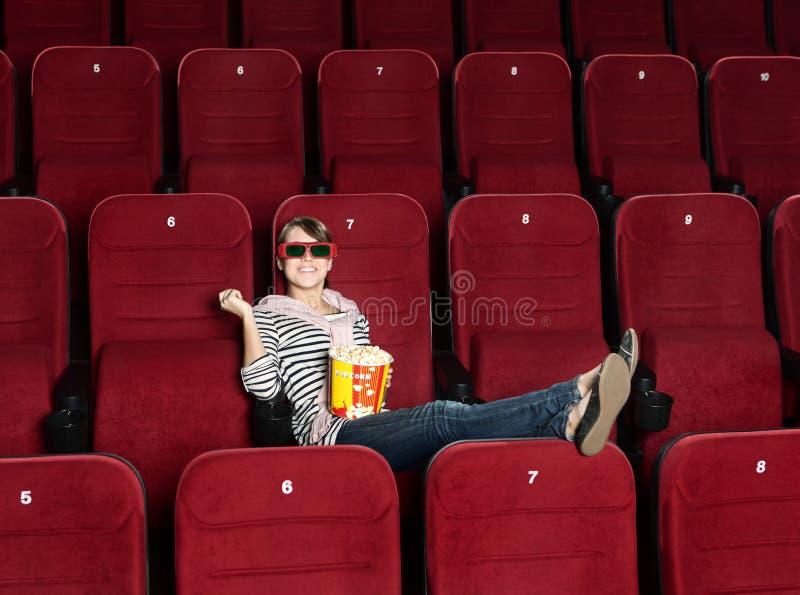 3d电影微笑的剧院妇女 库存照片