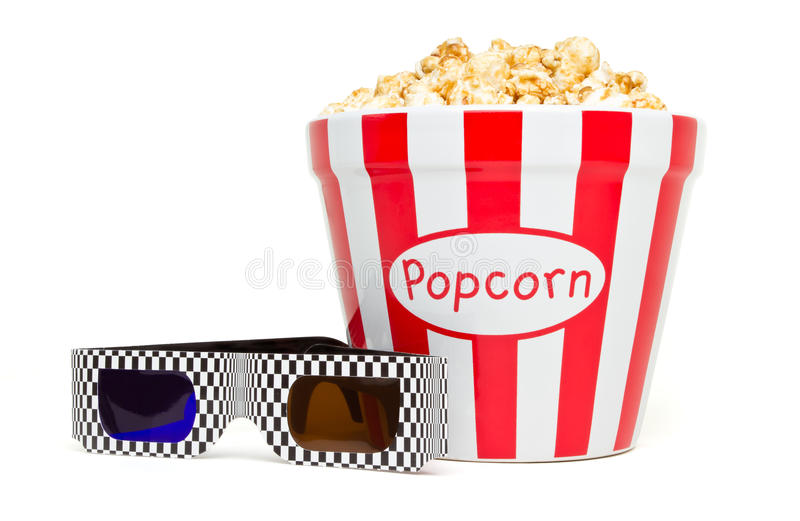 3D popcorn. Red and white bowl of popcorn with 3D glasses from low perspective isolated on white stock photo