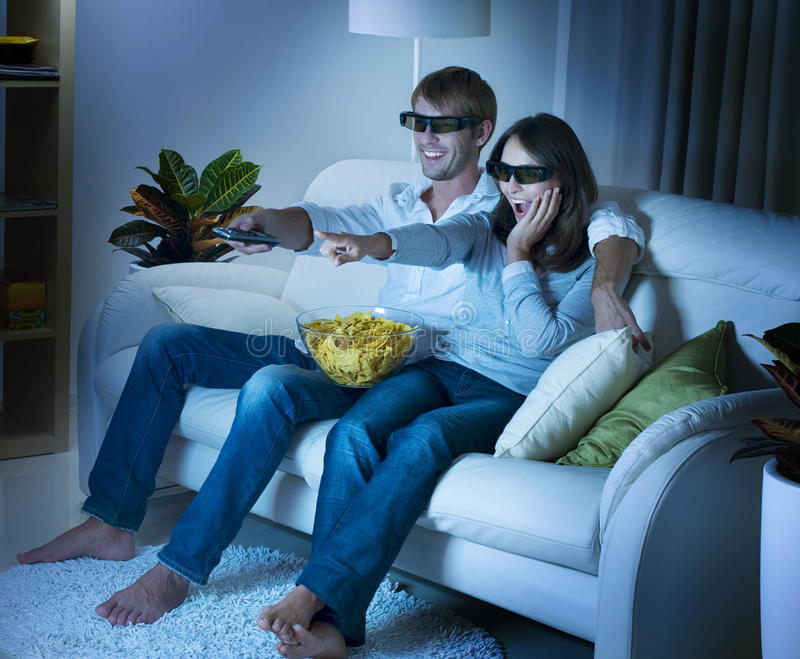 3D TV. Family watching 3D film on TV