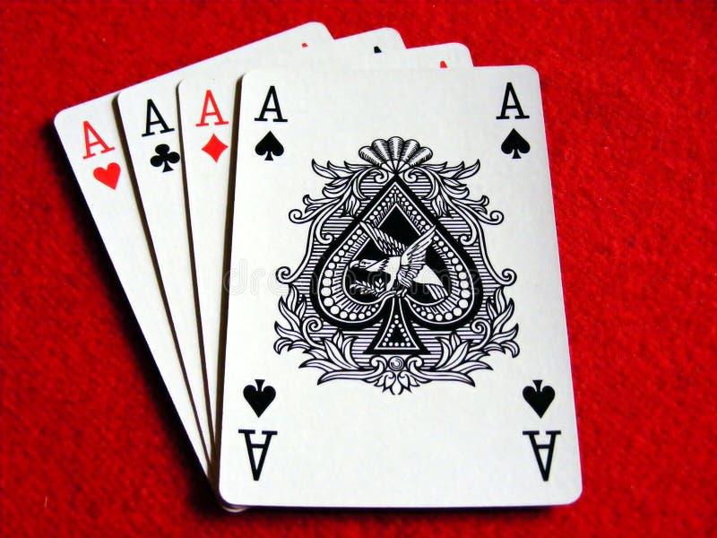 4 άσσοι δίνουν το πόκερ στοκ εικόνες