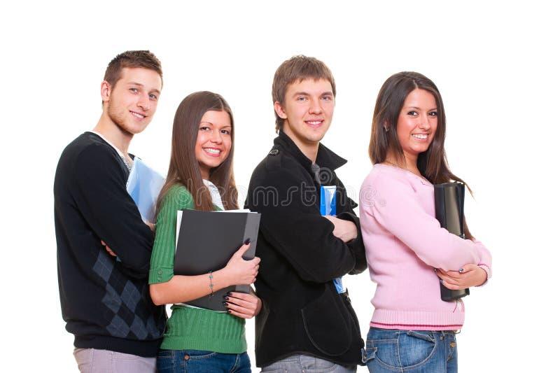 4 студента smiley стоковые фотографии rf