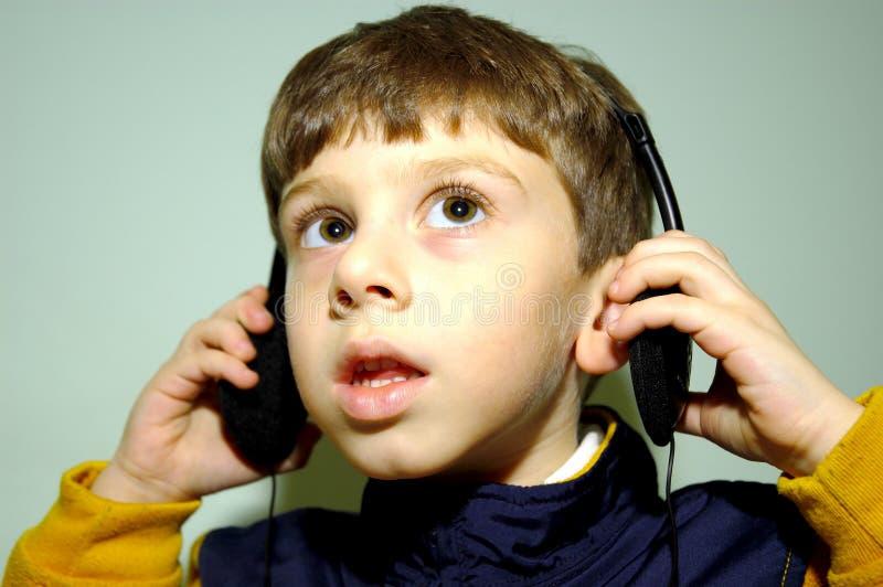 4 barnhörlurar arkivfoto