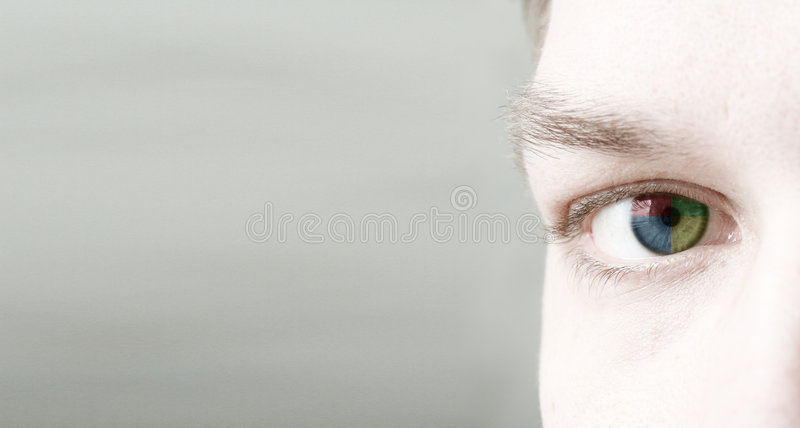 4 colorise eye (it). A close up of a cybersport men's eye (in color royalty free illustration