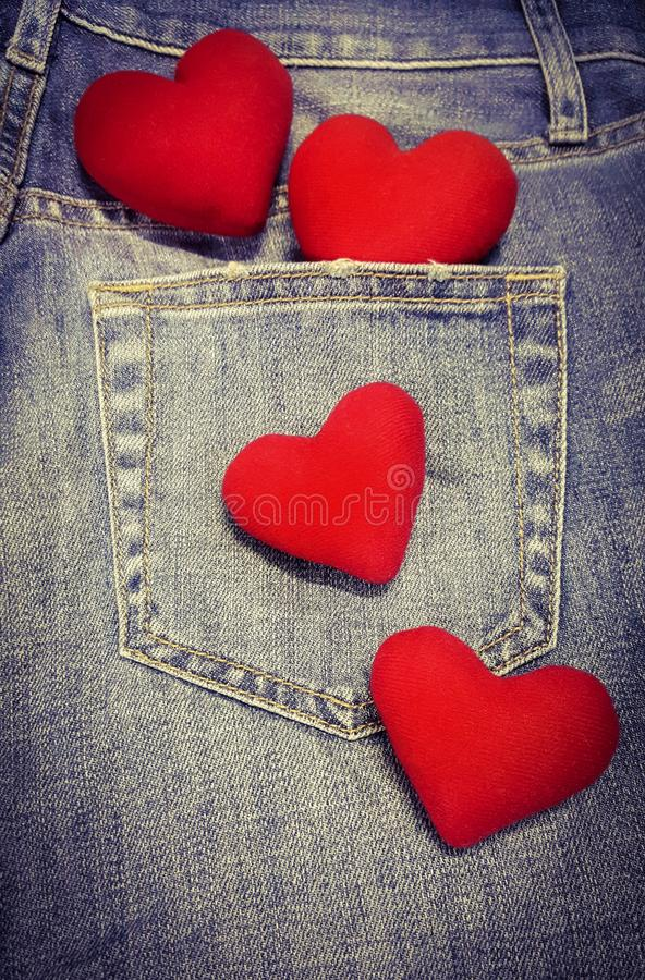 Free 4 Hearts Isolated On Blue Jean Background With Copy Space Stock Photos - 158429033
