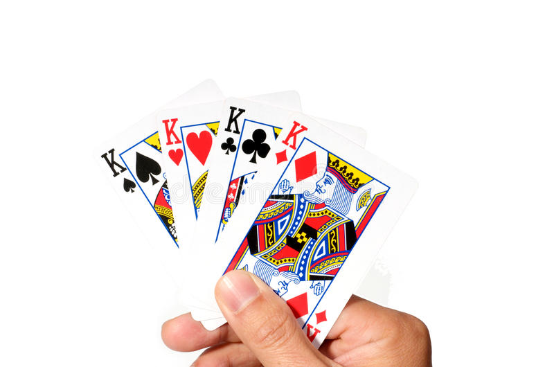 4 Kings in hand. Hand with 4 cards of kings stock photography
