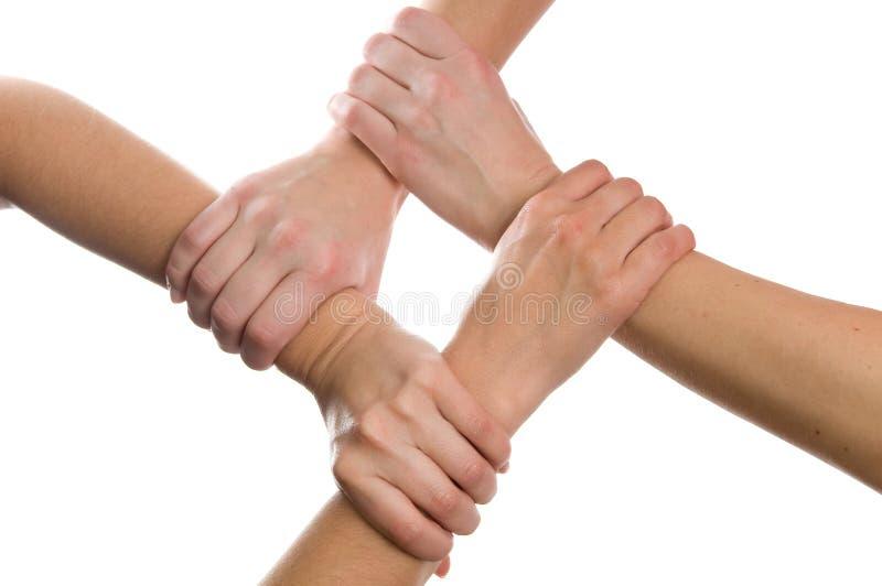 4 mãos conectadas foto de stock