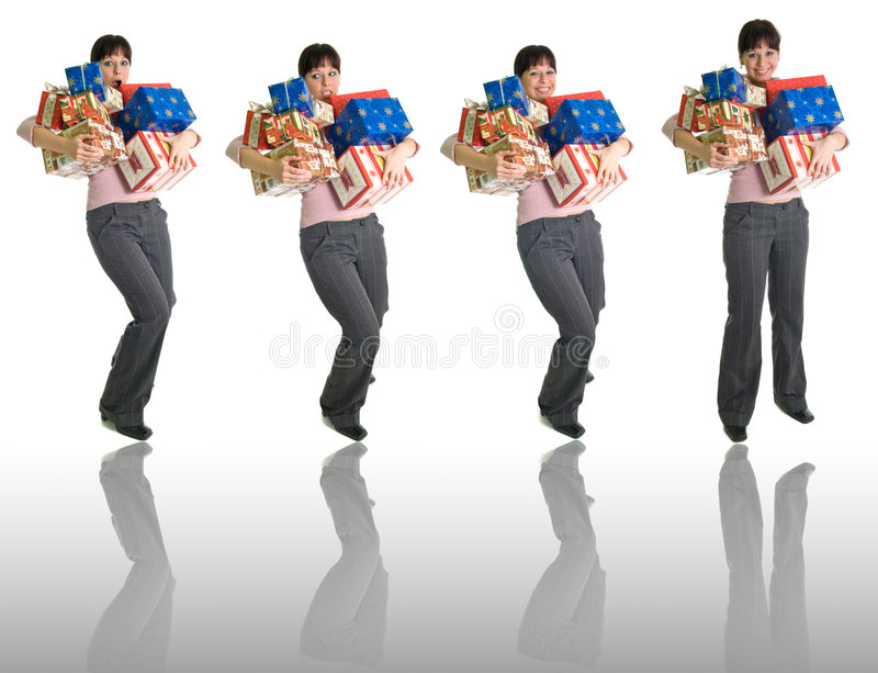 4 poses of a girl with full hands of presents. Girl with armful of presents isolated over white with reflection - 4 poses royalty free stock photos