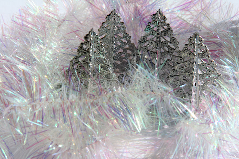 4 silver chrismas trees and pearl tinsel royalty free stock images