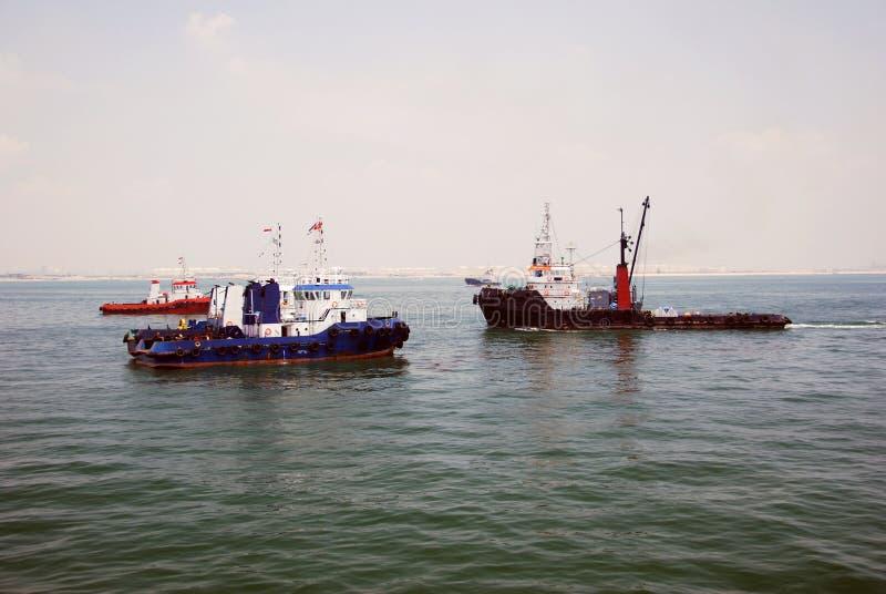 4 tug boats Singapore anchorage. royalty free stock image