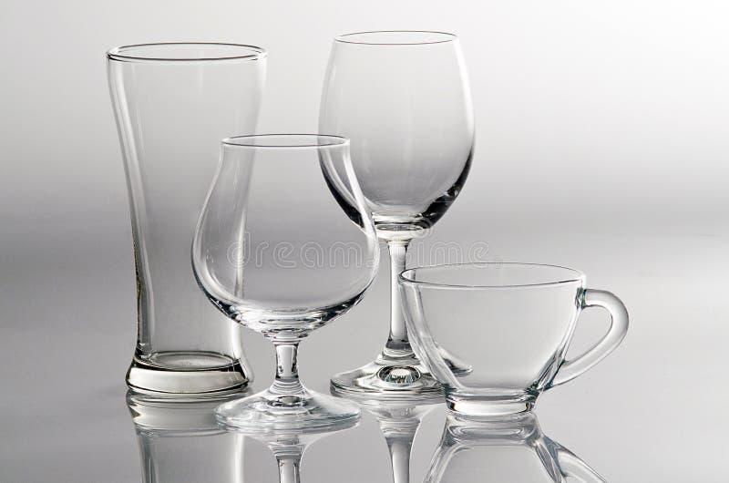 4 vidros vazios no estilo diferente fotos de stock