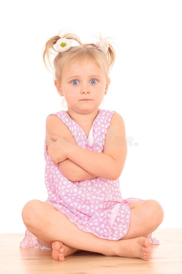 4 years old angry girl. Portrait of 4 years old angry girl in pink dress isolated on white royalty free stock photography