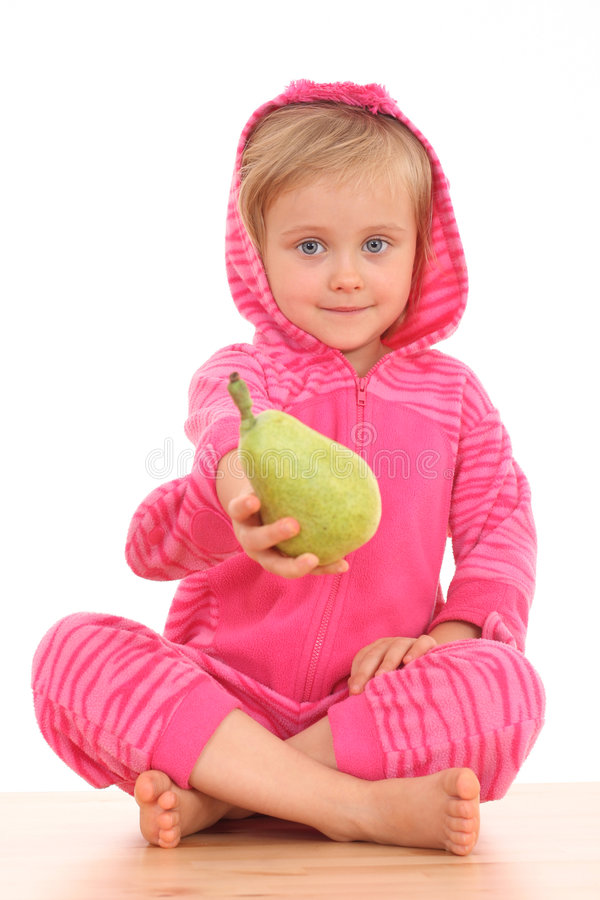 4 years old girl with pear. 4 years old girl with green pear isolated on white stock photo