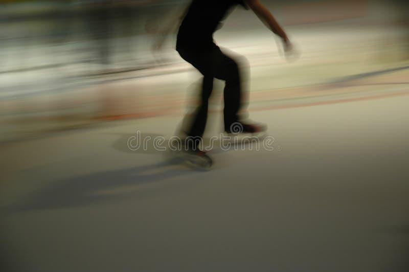 黑暗的溜冰者 库存图片