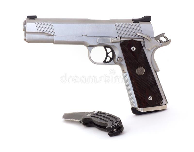 45 caliber pistol and knife royalty free stock photos