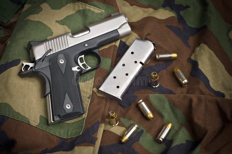 45 Firearm, Pistol Clip, Gun Ammunition On Camo Stock Images