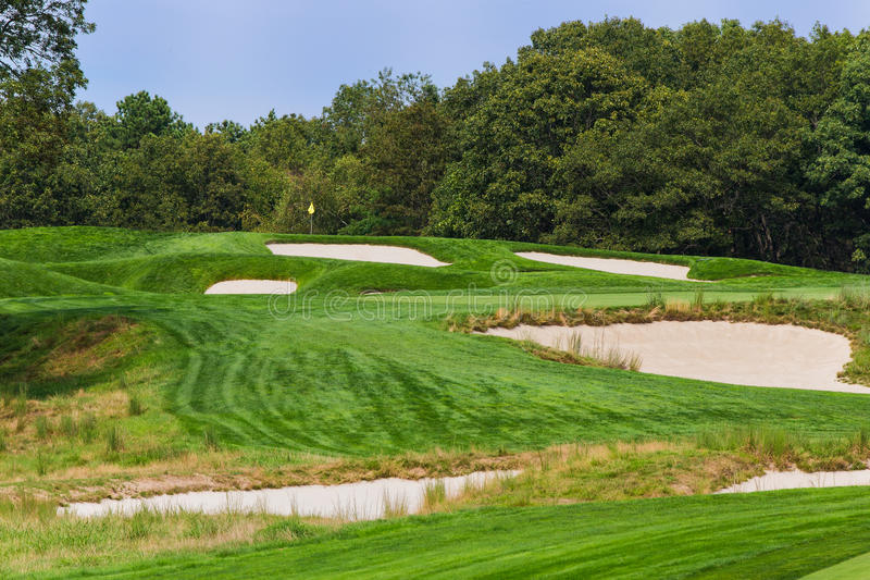 The 4th at Bethpage Black. FARMINGDALE, NY - AUGUST 21: The 4th on Bethpage State Park's black course on August 21, 2012 in Farmingdale, NY. Designed by AW royalty free stock photos